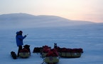 This photo provided by the Bancroft Arnesen Explore shows Ann Bancroft of Minnesota talking on a satellite phone during a North Pole expedition with N
