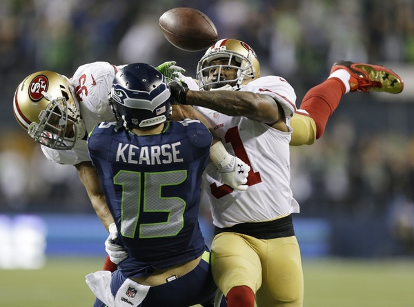 San Francisco 49ers' Eric Reid (35) and Donte Whitner (31) break up a pass intended for Seattle Seahawks' Jermaine Kearse during the second half of th