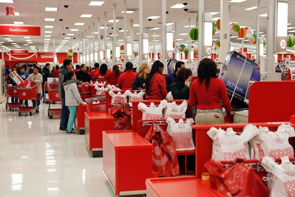 Target is joining other retailers in lifting its minimum pay for store workers to $9/hour. File photo of a Target store in Chicago.