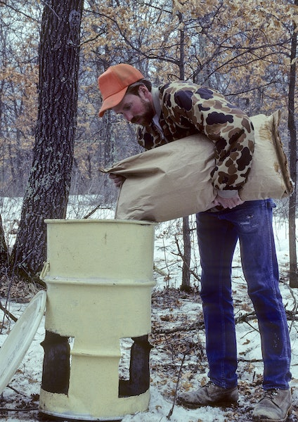 Photos from 1989: Officials say feeders won't be used this winter; instead, feed will be scattered in the woods.