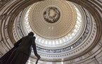 The Capitol Rotunda looms over the statue of George Washington on Capitol Hill in Washington, Monday, Jan. 27, 2014, as the House and Senate resume wo