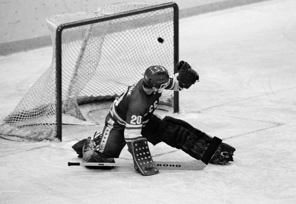 FILE - In this 1980 file photo, Soviet goalie Vladislav Tretiak allows a goal by the U.S. team in the first period of a medal-round hockey game at the