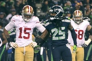 Seattle Seahawks cornerback Richard Sherman rubbed in the defeat after knocking away a pass from San Francisco wide receiver Michael Crabtree (15) in