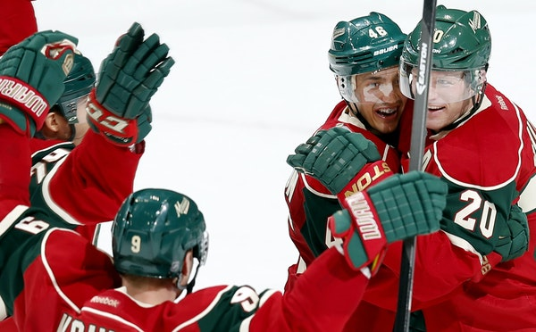 øCaptain Mikko Koivu, front left, was among those congratulating Ryan Suter (20), whose goal late in the third period against Boston sent the Wild