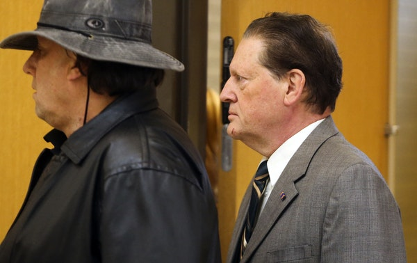 Byron Smith, right, arrived at the courthouse with an unidentified man before the start of Smith's trial for the slayings of 17-year-old Nick Brady