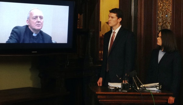 Attorneys watched video of the deposition of the Rev. Kevin McDonough during a news conference on Thursday.