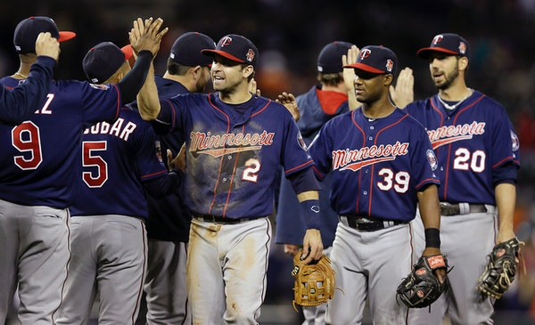 Minnesota Twins second baseman Brian Dozier (2), shortstop Danny Santana (39) and right fielder Chris Colabello (20) celebrate their 2-1 win over the