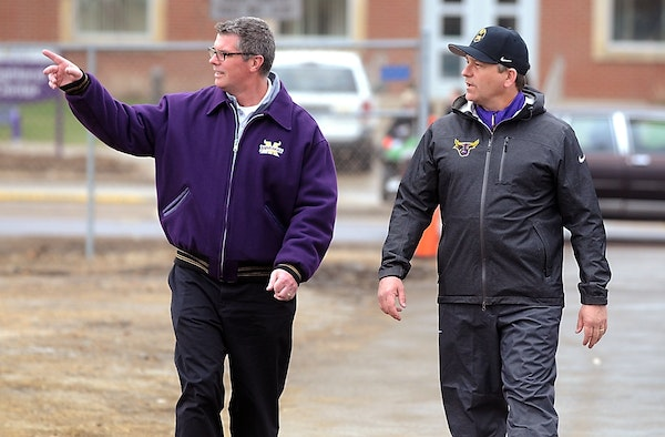 Minnesota State, Mankato athletic director Kevin Buisman, left, walks with football coach Todd Hoffner before Hoffner's first practice after being rei