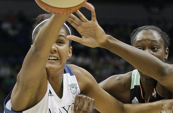 Minnesota Lynx forward Damiris Dantas (34) and New York Liberty center Tina Charles (31) reach for the ball in the first half of a WNBA basketball gam