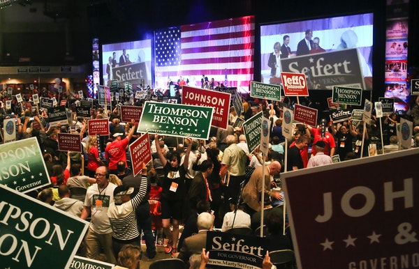 The aisles were crowded and filled with competing political placards during the Republican Governor's nomination race at the Minnesota Republican Part
