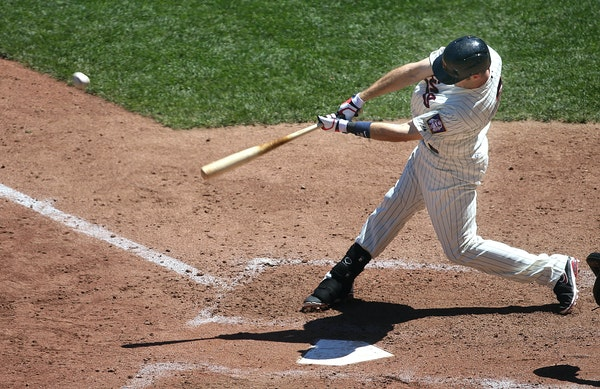 Joe Mauer hit a double and drove in two runs in the fifth inning Saturday against the White Sox.