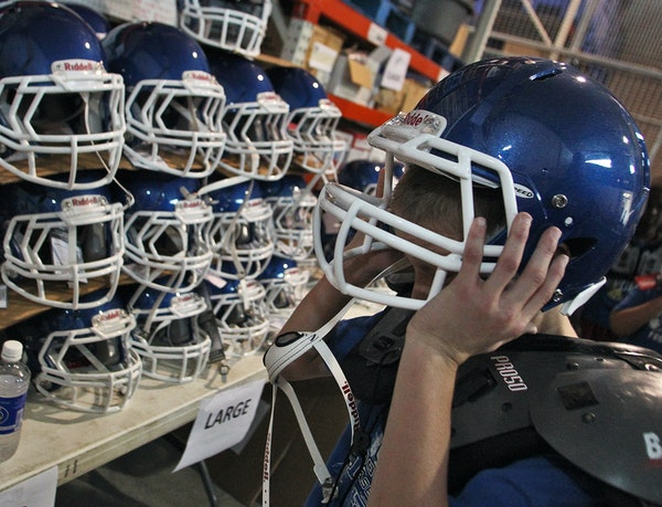 A Woodbury Athletic Association youth football signup in 2014 put recently purchased helmets to the test.
