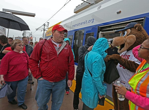 The public and dignitaries boarded the first Green Line train to leave Target Field Station on 6/14/14. Twins mascot TC was on hand for the opening.]