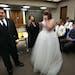 District Court Judge Tamara Garcia talked with Eric Seybert and Ashley (Aldrich) Seybert, of Richfield, after she performed their wedding ceremony in