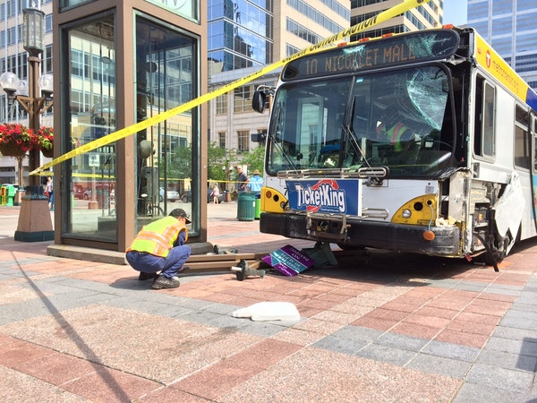 The city bus suffered major damage to the front.