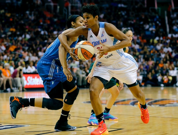 East's Angel McCoughtry, right, of the Atlanta Dream, drives past West's Maya Moore, of the Lynx, during the second half the WNBA All-Star basketball