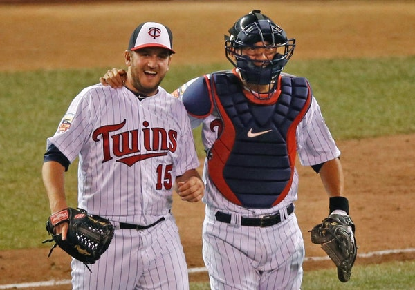 Glen Perkins smiled with catcher Kurt Suzuki after earning the save in the All-Star Game at Target Field last July.
