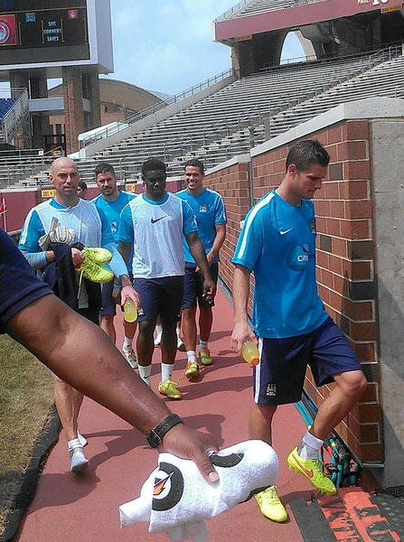 Players from Manchester City left the pitch at TCF Bank Stadium after a Friday practice. The team manager said the temporary grass field is substandar