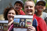 Blake Fry and his wife, Michele, held their coveted All-Star Game tickets. With them were their kids Liam, 7, and Abby, 11.