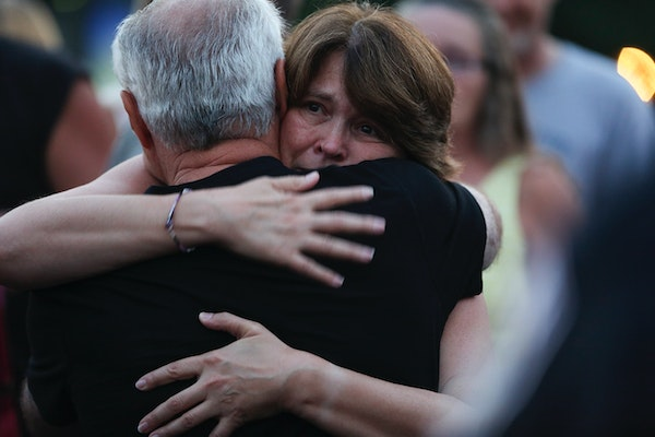 Michelle Patrick was hugged by many people as she attended a press conference at the scene of the shooting of her husband Mendota Heights Officer Scot