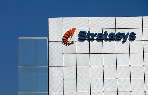 Stratasys shares fell sharply after the company warned about its 2015 performance and wrote down a portion of its MakerBot acquisition.
