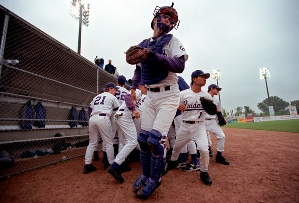 In 2001, Joe Mauer (middle) helped Cretin-Derham Hall win a section and a state title at St.Paul's Midway Stadium.