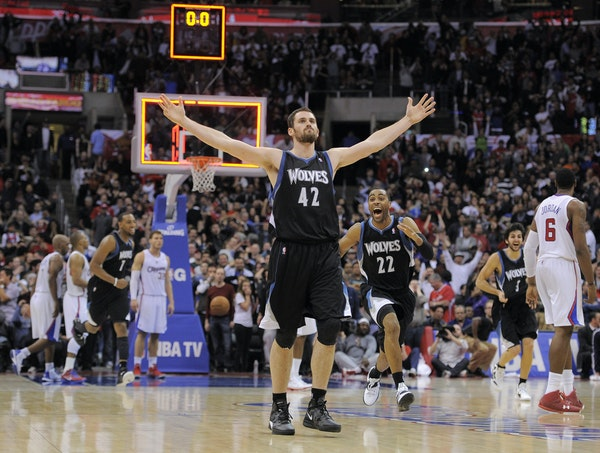 Minnesota Timberwolves forward Kevin Love (42) reacts with guard Wayne Ellington (22) after hitting a three point shot to win the game during the seco