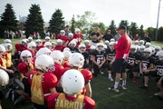Sixth-grade Commissioner Sal Fialo talked to football players during a scrimmage at Eden Prairie High School last week. Eden Prairie has enough footba