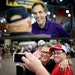 Top: GOP Senate candidate Mike McFadden laughed with Larry and Evy Walters of Brooklyn Park in the State Fair Cattle Barn. At bottom, Sen. Al Franken