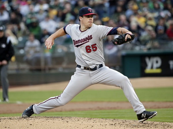 Minnesota Twins starting pitcher Trevor May throws to the Oakland Athletics during the second inning of a baseball game on Saturday, Aug. 9, 2014, in