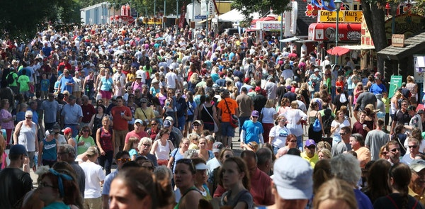 Thousands of fairgoers pack the fairground at the Minnesota State Fair, Monday, Aug. 25, 2014 in Falcon Heights, Minn. (AP Photo/Jim Mone)