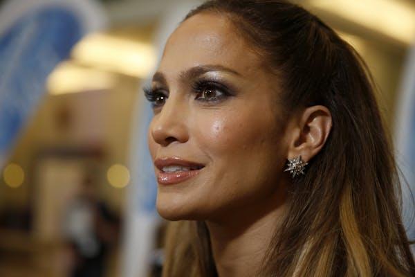 American Idol judge Jennifer Lopez talks to local media at the Minneapolis Convention Center to judge the local American Idol XIV auditions on Wednesd