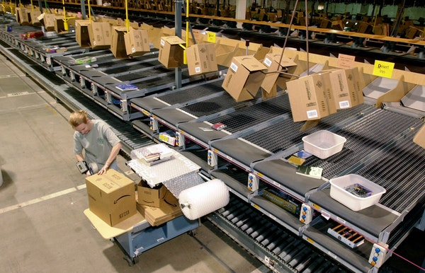 An Amazon employee packaged an order to be shipped from its Coffeyville, Kan., warehouse.