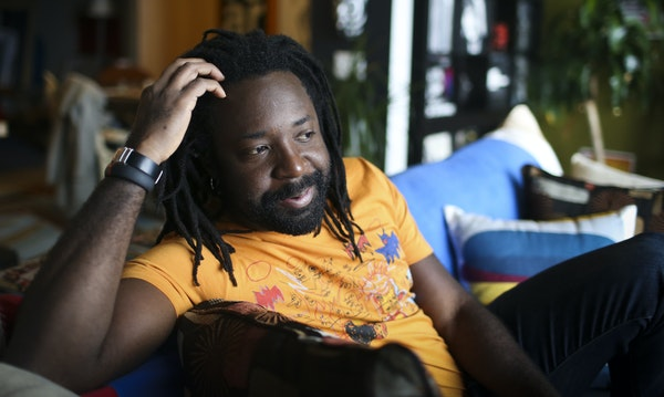 """Marlon James at home in Minneapolis. A fellow Jamaican writer says James is """"channeling a reggae aesthetic that's being overdubbed on literary sty"""