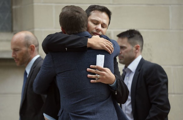 Nathon Bailey hugged a friend after speaking at a news conference about the arrest of Ty Hoffman at St. Mark 's Episcopal Cathedral. Hoffman was arres