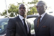Minnesota Vikings running back Adrian Peterson, left, arrives for court in Conroe, Texas, in October.