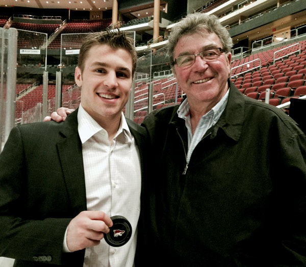 Zach Parise, left, and his father, J.P. Parise, in a photo taken last year in Phoenix when Zach passed his father on the all-time goal-scoring list. I