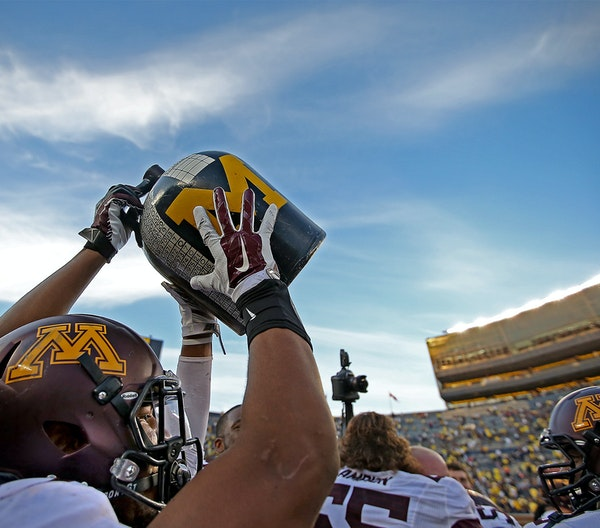 Gophers tailback David Cobb grabbed the Little Brown Jug after the victory over Michigan, which could be a launching point for a big 2014.
