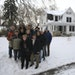 Neighbors gathered for a portrait in front of the 104-year-old house that is to be replaced with two houses. The owners expect the new structures to b