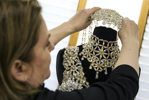 """Be held """"Erotic Ice,"""" a headpiece valued at $7,500, which she lent to Lady Gaga for the release of her duet single """"Anything Goes."""""""