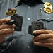 Minneapolis police Lt. Greg Reinhardt displayed two of the body cameras made by Taser, used during a department test.