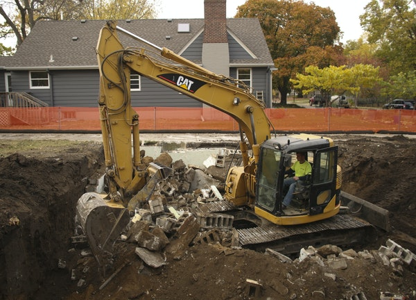 In a typical scene for Edina neighborhoods, a worker broke up a foundation on the 4300 block of Oakdale Avenue S.