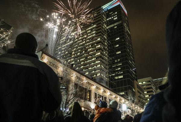 Fireworks light the cold night sky over downtown Minneapolis, launched from Vincent's on Friday as part of the opening of the reimagined Holidazzle.
