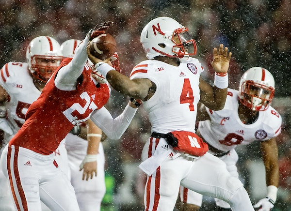 Wisconsin defensive back Austin Hudson (27) just gets his hand on the ball to force a fumble by Nebraska quarterback Tommy Armstrong Jr. (4) during th