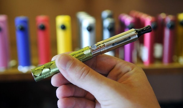 The electronic cigarette consists of a battery on the bottom and a bottom-coiled tank on top. Electronic cigarettes are growing in popularity, but con