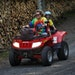 Rachelle Petersen drove an ATV while her 4-year-old grandson, Gabe, held onto the back seat during a ride in Luck, Wis.