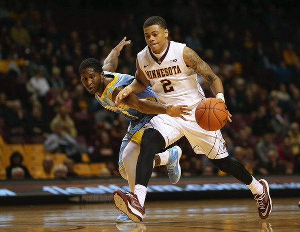 Gophers guard Nate Mason (2) outran the defense of Southern University Jaguars guard Michael Harrel (5) while driving up court in the second half Wedn