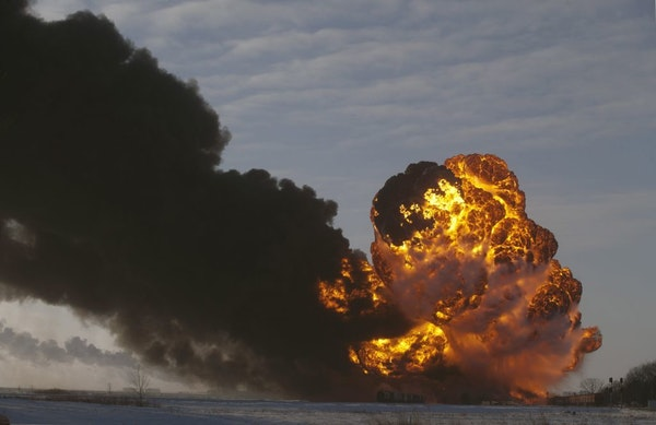 FILE - In this Dec. 30, 2013 file photo, a fireball goes up at the site of an oil train derailment in Casselton, N.D. North Dakota officials on Tuesda