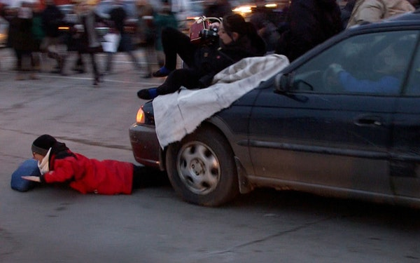 One protester was pinned as a driver plowed into the crowd blocking the intersection at Lake Street and Minnehaha Avenue S.