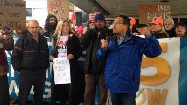 Kip Hedges stands next to Rep. Keith Ellison at a recent demonstration at the Minneapolis-St. Paul Airport.